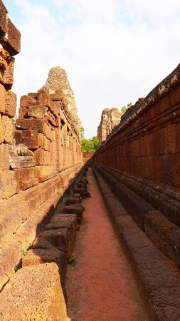 Stone rock wall at Ancient buddhist khmer temple architecture ruin of Pre Rup in Angkor Wat complex, Siem Reap Cambodia.