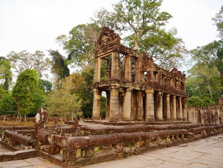 Landscape view of demolished stone architecture at Preah Khan temple Angkor Wat complex, Siem Reap Cambodia. A popular tourist attraction nestled among rainforest. Stock fotó