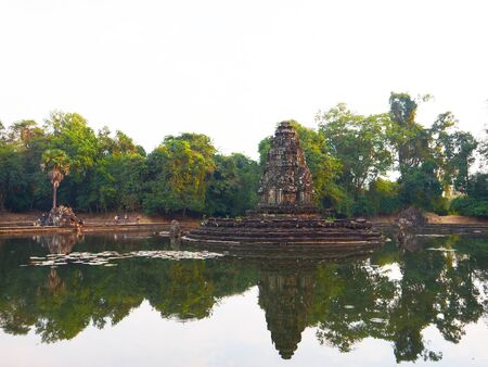 Landscape view with reflection of Neak Pean or Neak Poan in Angkor Wat complex, Siem Reap Cambodia