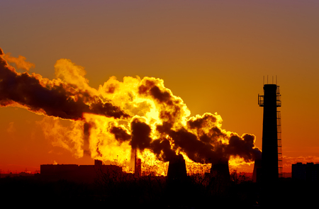 smokestacks: power plant smokestacks at sunset Stock Photo