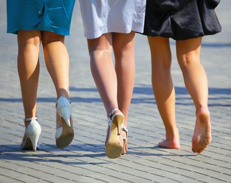 Three womens legs