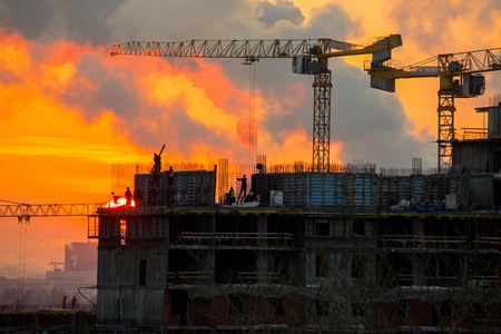 Home construction. sunset.