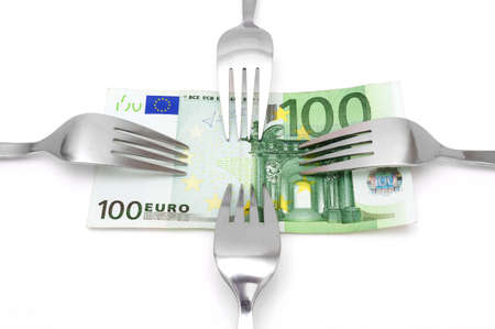 balanced budget: concept of tight budget with banknote and fork Stock Photo
