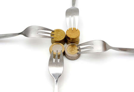 monetary policy: concept of tight budget with coins and fork Stock Photo