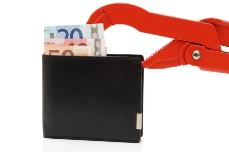 budget restrictions: money problems with wallet and pipe Wrench Stock Photo