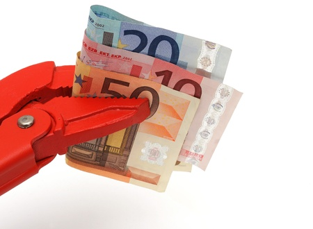 budget restrictions: concept of hard work  with money and pipe Wrench Stock Photo