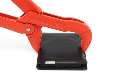 budget restrictions: concept of debt problems with wallet and pipe wrench