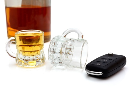 derail: concept of drunk driver with  bottle of whiskey, glasses and car keys