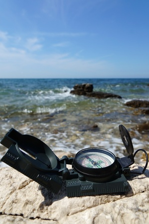 holiday destination concept with Compass on sea photo
