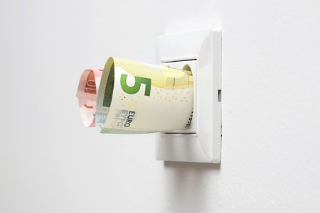 energy savings concept with power socket and money photo