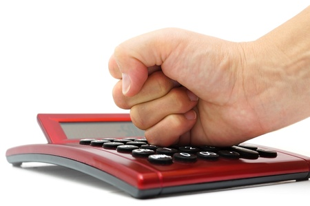 no mistake: financial mistake concept with woman hand hitting calculator Stock Photo