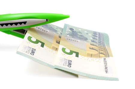 cutting costs: cutting costs concept with money, scissors