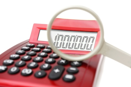 balanced budget: Fraud concept with magnifier and calculator