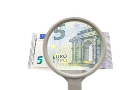 investigacion: concepto de investigación financiera con la lupa y el dinero
