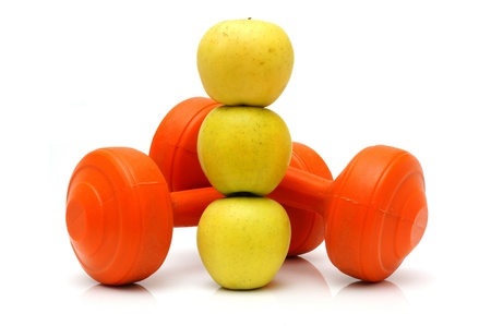 concept of healthy life with apples and weights photo