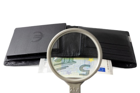 intrest: find investor concept with wallet and magnifier Stock Photo