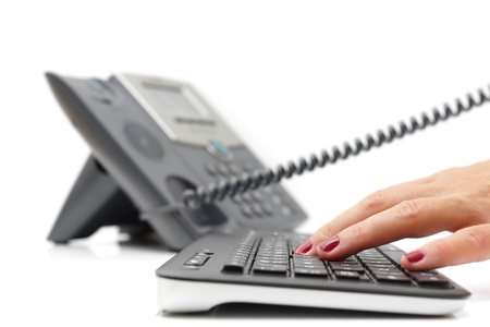 support desk: customer support concept with telephone and keyboard
