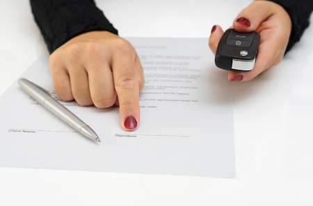 key handover: selling a new car Stock Photo