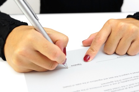 woman is signing contract photo
