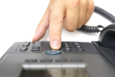 man hand is dialing a phone number, top view photo