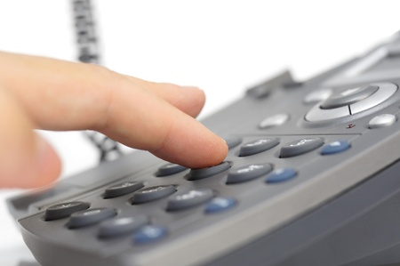 press agent: man hand is dialing a phone number with picked up headset