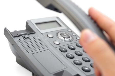 press agent: man s hand picking up the phone