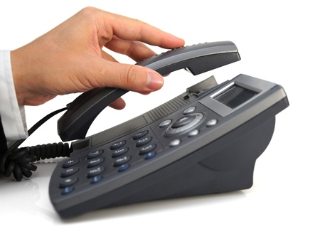 press agent: business mans hand is picking up headset Stock Photo