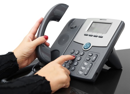female hand is dialing a phone number photo