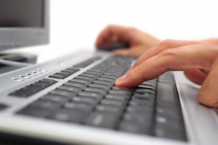 working on computer with keyboard and mouse photo