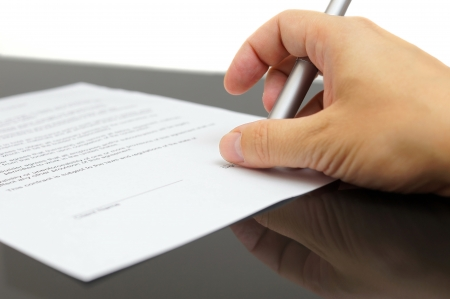 articles: businessman examines the articles of agreement before signing Stock Photo