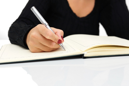 Secretary writing in her notepad photo