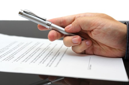 hand holding pen: Businessman offering  a pen to sign a contractt