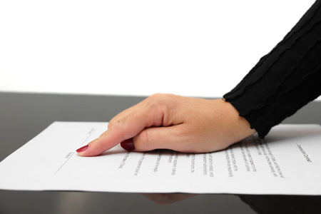 businesswoman showing contract and where to sign photo
