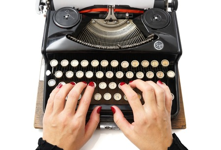 woman typing: close up of woman typing with old typewriter