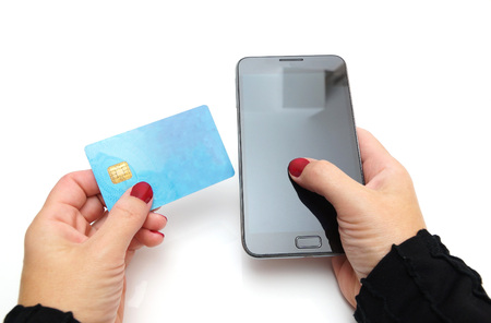 pay bill: Close-up Of Businesswoman Paying With Credit Card On Mobile Phone