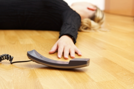 woman lying on the floor unconscious photo
