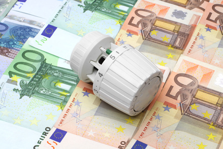 cheaper: concept of expensive central heating and energy savings