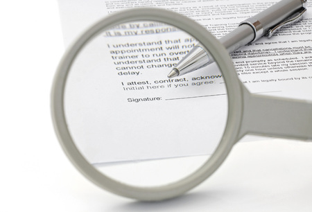 concept of good contract with magnifying Glass photo
