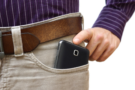 hands on pockets: too big mobile phone in pants