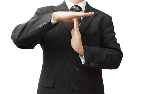 Businessman showing time out sign with hands