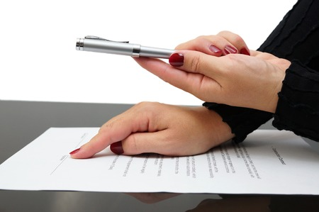 subscribing: Businesswoman offering  a pen to sign a agreement Stock Photo