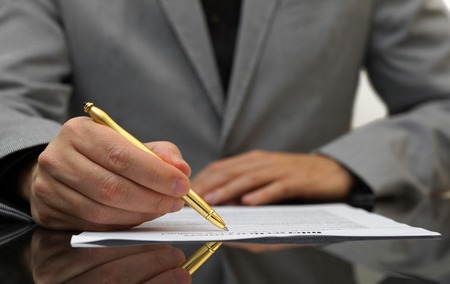 fulfilling: businessman is fulfilling and signing contract Stock Photo