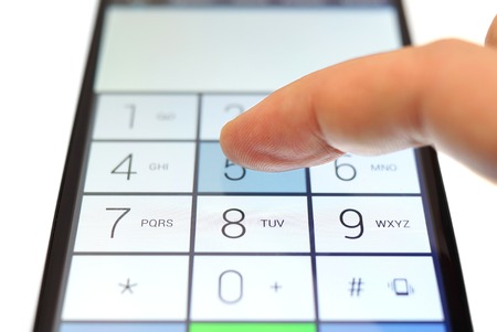 dialing: dialing on touchscreen smartphone Stock Photo