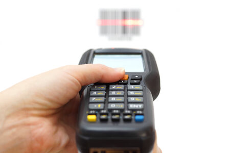 traceability: woman hold scanner and scans barcode with laser Stock Photo