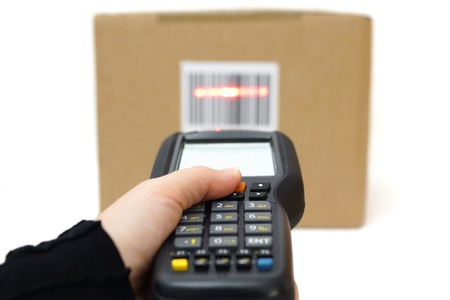 inventory: woman hold scanner and scans barcode with laser Stock Photo