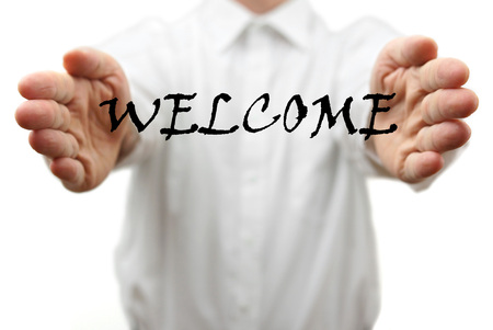 man makes a welcome gesture with welcome word photo