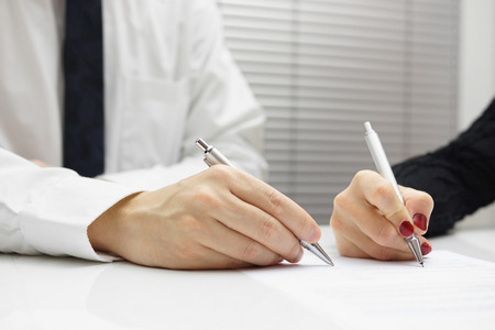 dismissal: business partners signing a document