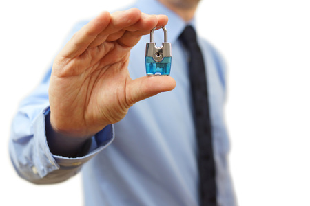 concept protect your business with  businessman with a padlock photo