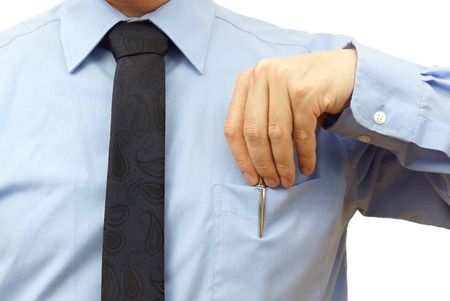 white collars: businessman is putting pen back into his pocket