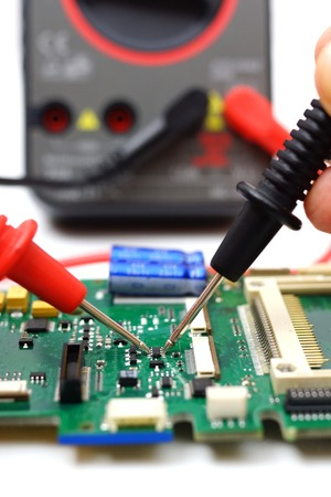engineer is checking electronic component photo